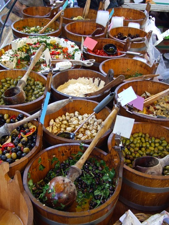 artisan: Artisan food in wooden buckets at farmers market