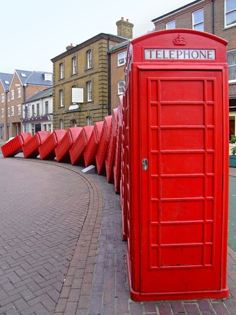 dominoes: Classic British red telephone boxes in Kingston Stock Photo
