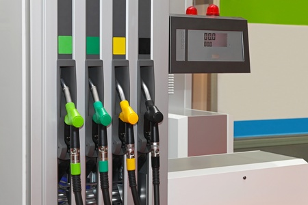 coded: Color coded fuel nozzles at petrol station