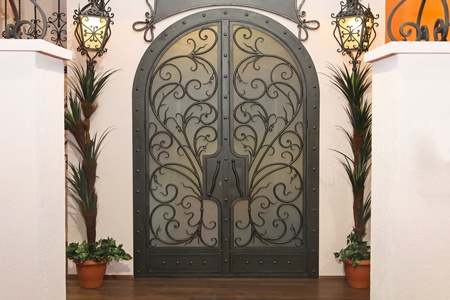 Decorative double iron doors with arch Stock Photo