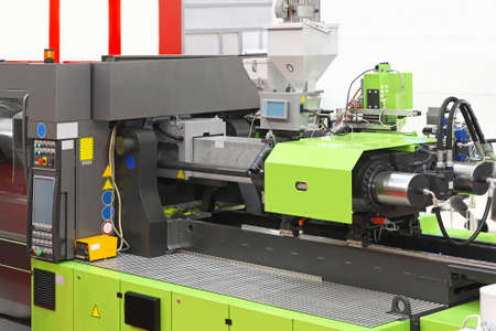 plastics: Injection moulding machine for plastic parts production Stock Photo