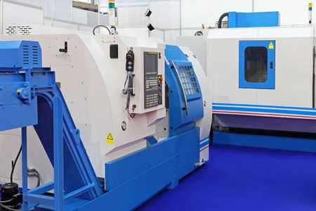 on the lathe: CNC Lathe machines for metal production in factory Stock Photo