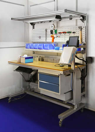 Technician workbench desk with shelves amd tools photo