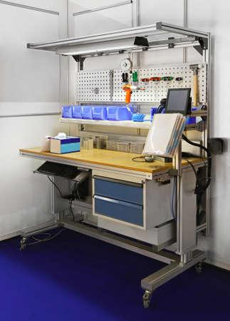workbench: Technician workbench desk with shelves amd tools Stock Photo