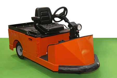 tow tractor: Orange tug tow tractor for material handling