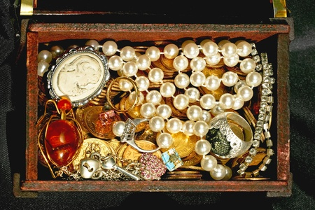 valuables: Jewellery and valuables in wooden chest Stock Photo