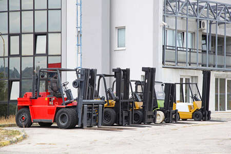 forklifts: Commercial forklifts in front of distribution warehouse Stock Photo