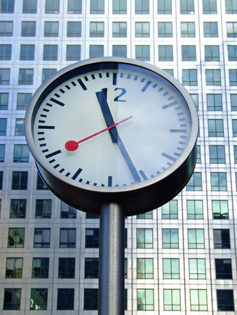bussines: Bussines clock in front of office building