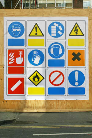 hazard signs: Construction site health and safety signs and symbols Stock Photo