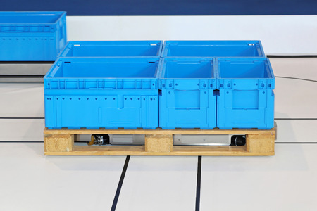 guided: Automated guided pallet with blue boxes