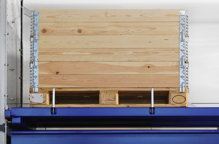 Transportation pallet with wooden crate at shelf photo
