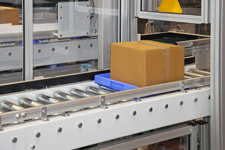 carboard box: Carboard box at conveyor rollers in factory