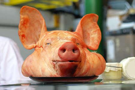 Big pig head in bucher shop