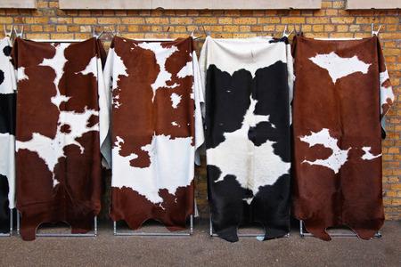cowhide: Four cow hides with unique patterns