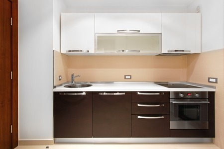 Kitchen counter and modern cabinets in new apartment Stock Photo