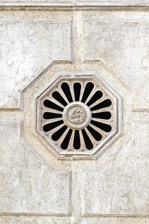 octagon: White marble stone octagon window detail Stock Photo