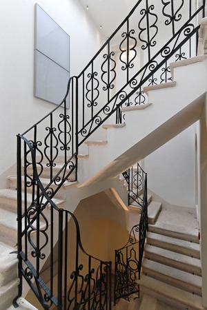 banister: Stairs with iron banister in old house Stock Photo