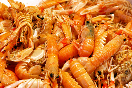 decapods: Bunch of big fresh shrimps at market Stock Photo
