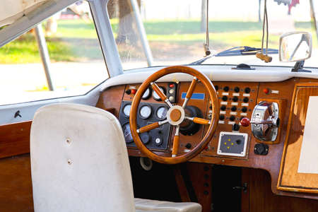 Wooden dashboard of a retro motor boat photo