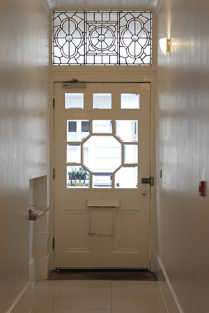 Glass door and typical narrow corridor in old London house photo