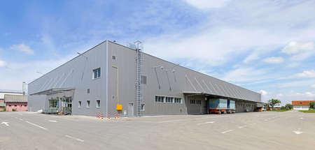 Big gray distribution warehouse building Stock Photo
