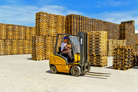 pallet truck: Forklift operator in pallet warehouse on the open Stock Photo