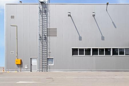 warehouse building: Gray distribution warehouse building exterior Stock Photo