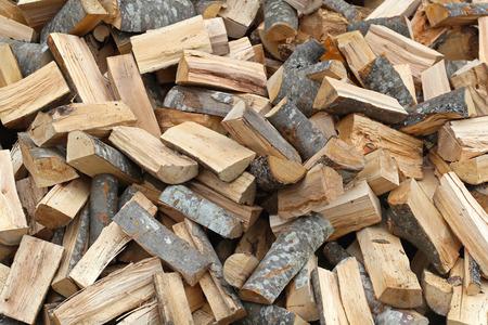 Big pile of split firewood fuel material Stock Photo
