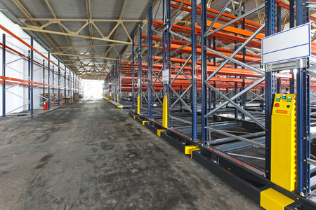 shelving: Powered mobile shelving system in distribution warehouse