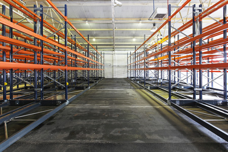 Empty shelves and racks in distribution warehouse photo