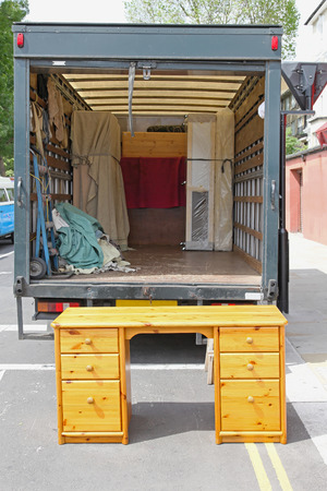Open rear end of moving furniture truck photo