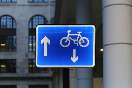 bicycle lane: Illuminated blue sign for bicycle lane