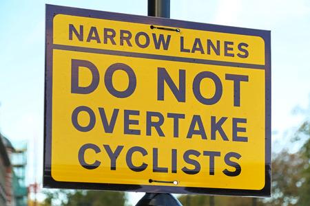 overtake: Do not overtake cyclist yellow traffic sign