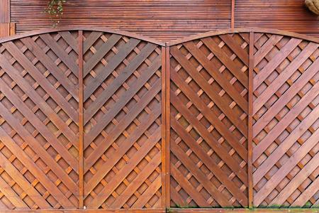 fence panel: Brown wood fencing panels in garden