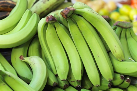bannana: Big bunch of green bananas at grocery store Stock Photo