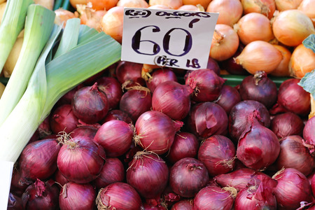 Red onions for sale at farmers market