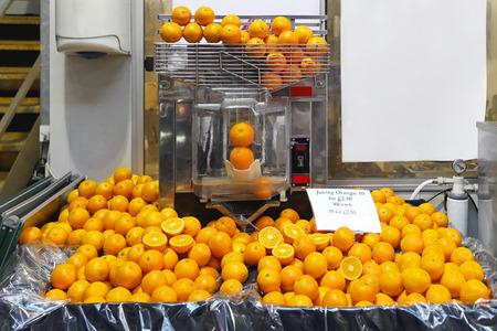freshly: Orange juicer machine for freshly squeezed juice Stock Photo