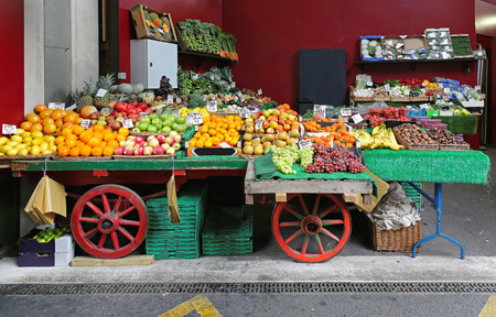 stall: Fruits and vegetables in cart at market Stock Photo
