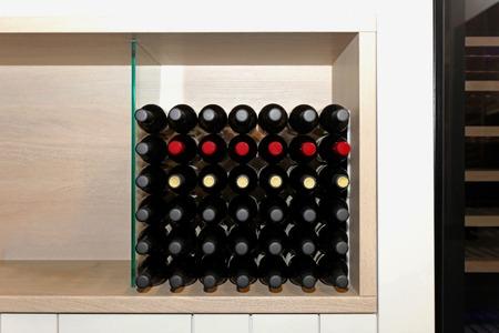 pantry: Bottles of wine at shelf in kitchen pantry Stock Photo