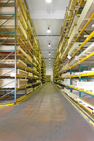 warehouse building: Shelves with wood building materials in warehouse