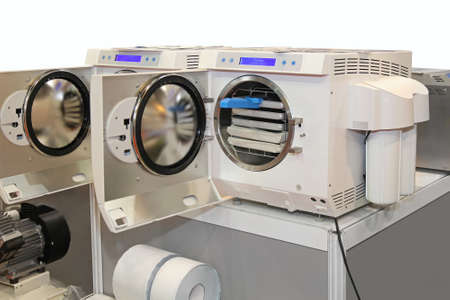 doors open: Modern front loading autoclave sterilization unit with pressure chamber