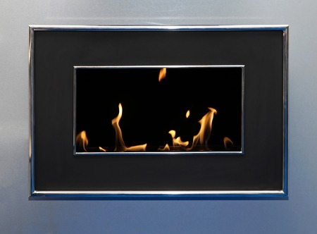 firebox: Oil burning flames in contemporary metal fireplace