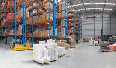 Distribution centre with high rack shelving system photo