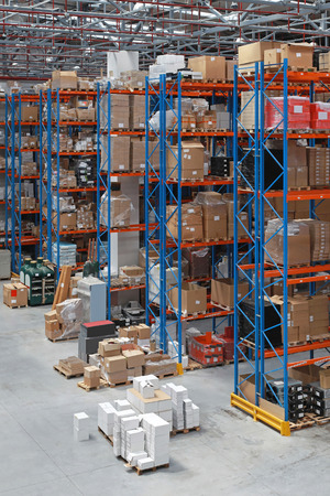 shelving: Distribution warehouse with high rack shelving system Stock Photo