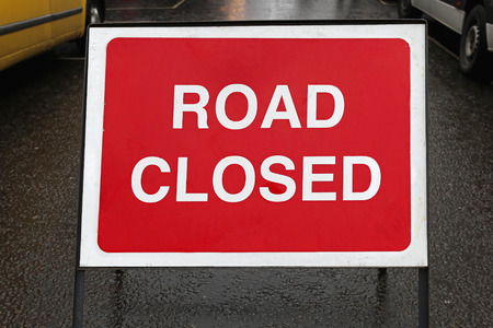 informing: Street sign informing about closed road ahead Stock Photo