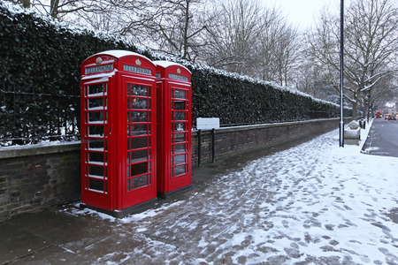 Telephone booths and street covered with snow in London photo