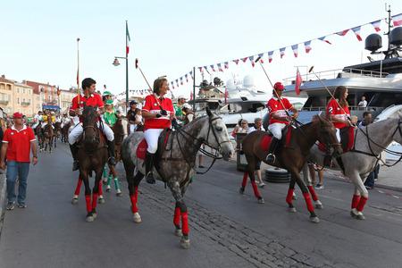 tropez: SAINT TROPEZ, FRANCE - JULY 12  Saint Tropez Polo Team on JULY 12, 2013  Saint Tropez Polo Team parade at horses during International Polo Cup in Saint Tropez, France