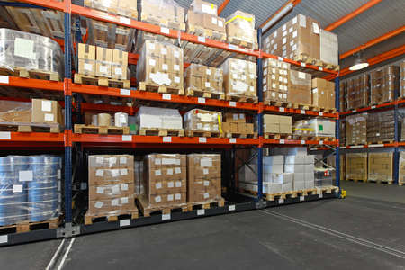 Mobile aisle racking system in distribution warehouse photo