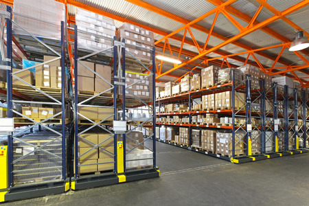 Mobile roller shelving system in distribution warehouse Stock Photo