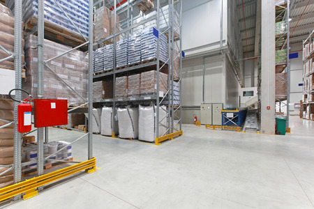 warehouse equipment: Shelves with food in distribution warehouse Stock Photo